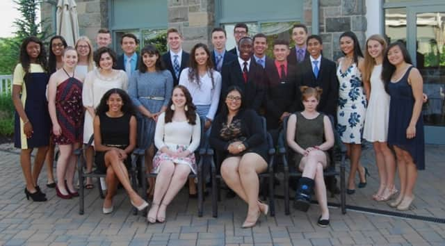 Recent grads of North Rockland High School's Academy of Finance pose for a group portrait.