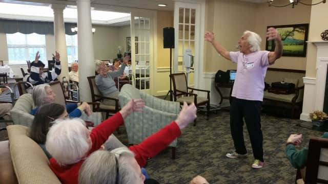 Atria Senior Living residents embrace active lifestyles by taking an exercise class at the assisted living faclity.