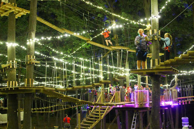 Thanks to The Adventure Park at The Discovery Museum's Glow in the Park night climb, area youths can enjoy a new kind of Friday night fun.
