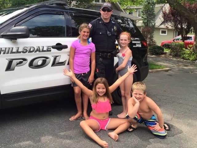 Hillsdale Police Officer Alex Kaplan and friends.