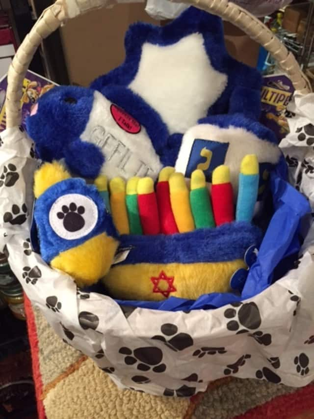 Squeaky toys with a Hannukah theme can be had for your family pet at All Paws, a Rye store.