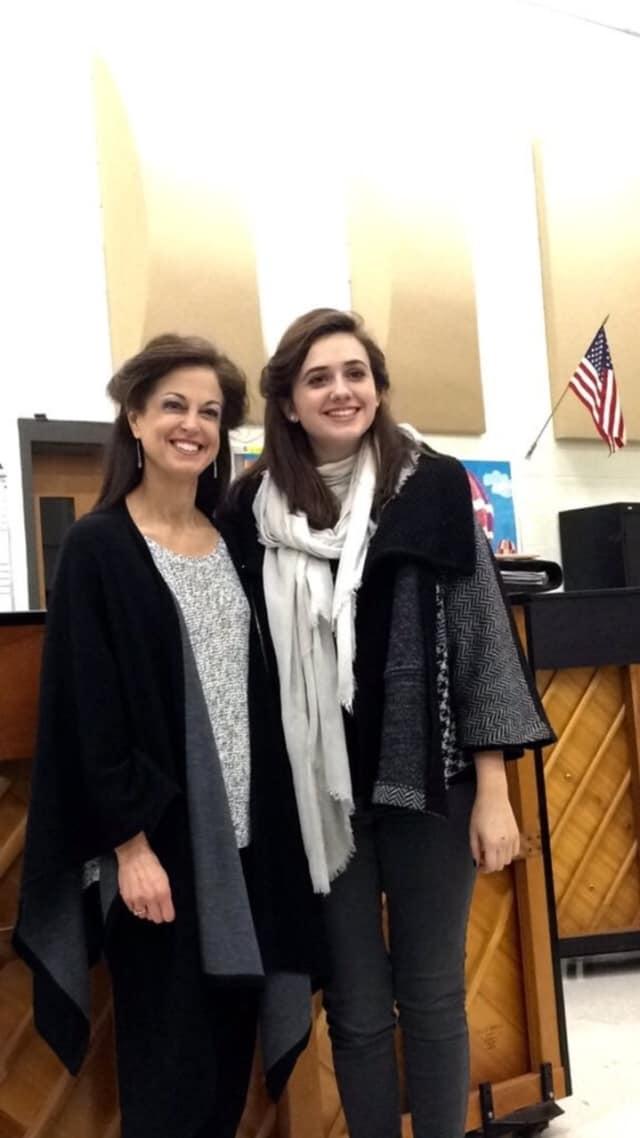 Choir director Anne Tornillo, left, is Trumbull High School's Teacher of the Year.