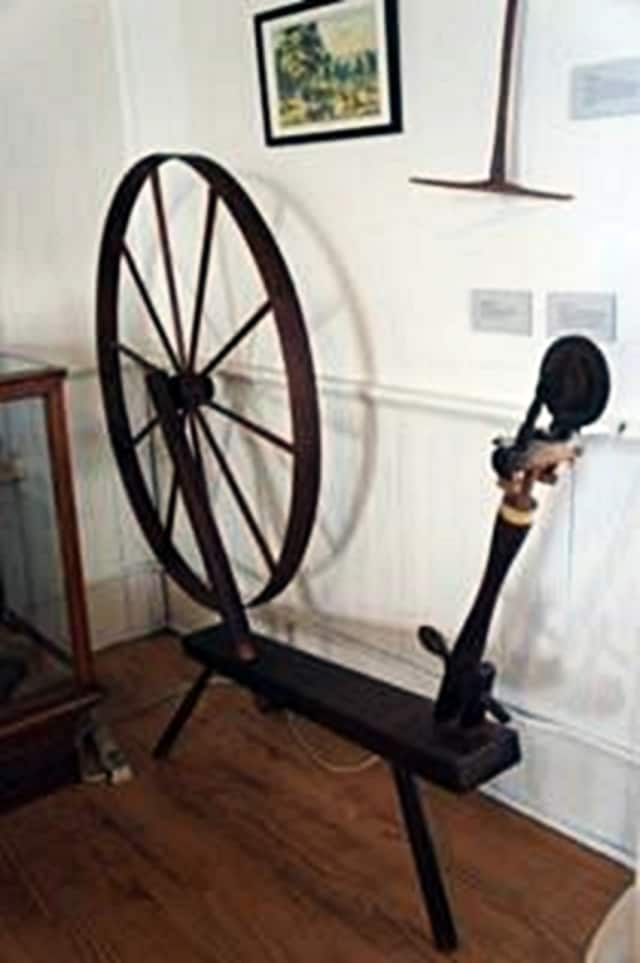 A demonstration of antique spinning wheels is part of the historical society's upcoming meeting.