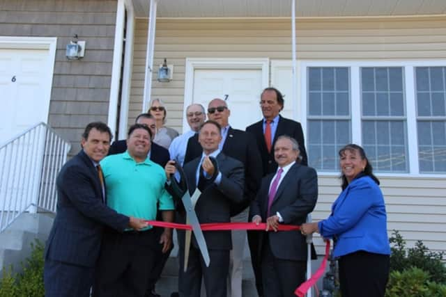 Westchester County Executive Rob Astorino cuts the ribbons on the county's newest affordable housing unit.