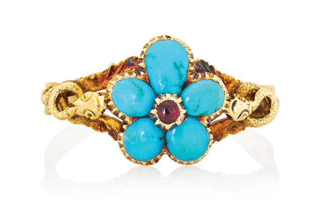 Victorian turquoise and gold forget-me-not and serpent ring, symbolizing faithfulness and eternal love, sold for $813. Courtesy Rago Auctions.