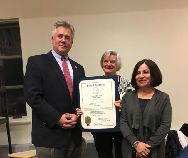 Eileen Buckley is presented with her proclamation by state Rep. John Shaban and state Sen. Toni Boucher.