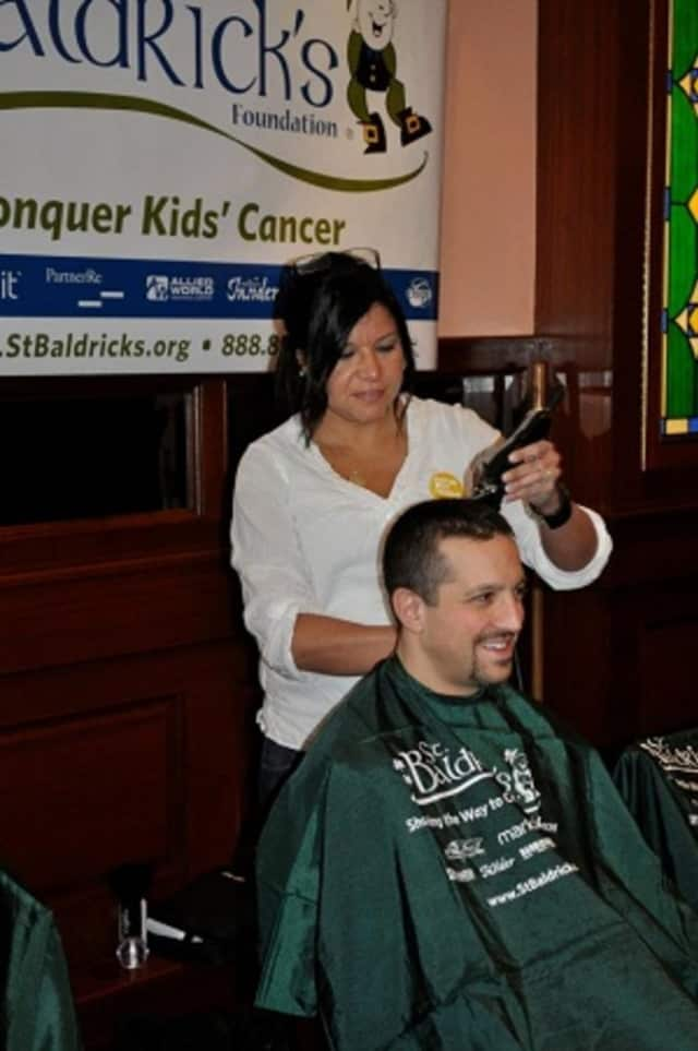 A volunteer gets his head shaved at a 2011 fundraiser sponsored by the Yonkers Police Benevolent Association. The annual event raises money for St. Baldrick's, a foundation that funds children's cancer research.