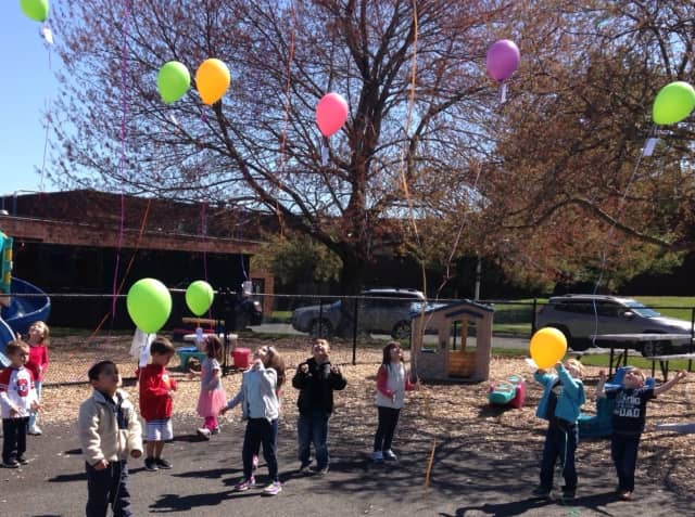 Youngsters at the Mahwah Child Care Center launched balloons, hoping to hear about their travels.