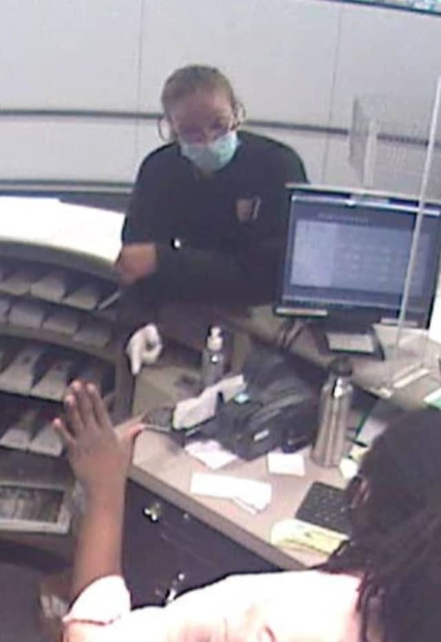 Know her? Police are asking for identifying a woman who allegedly robbed a People's Bank inside a Stop & Shop store.