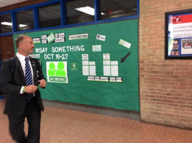 Mark Barden checks out the 'Say Something' campaign at Danbury High School.