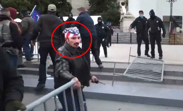A man identified as Beacon resident William Pepe is caught moving a barrier in a photo released by Justice Department.