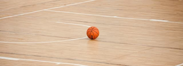 Two girl's basketball teams in Newark have been disqualified from post-season games after a player was injured in a brawl.