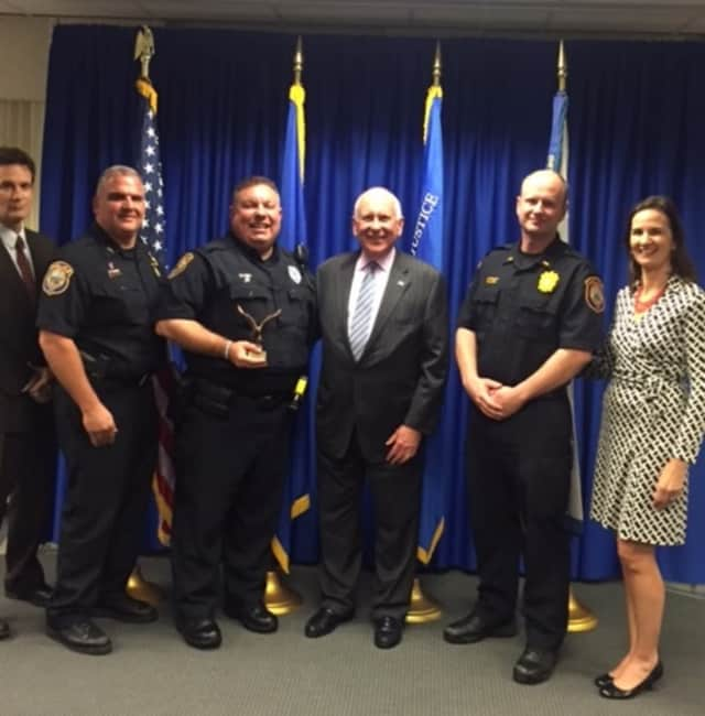 Pictured left to right are: U.S. Attorney Michael Gustafson, Chief Foti Koskinas, Officer Ned Batlin, First Selectman Jim Marpe, Lt. Ryan Paulsson and U.S. Attorney Deirdre M. Daly