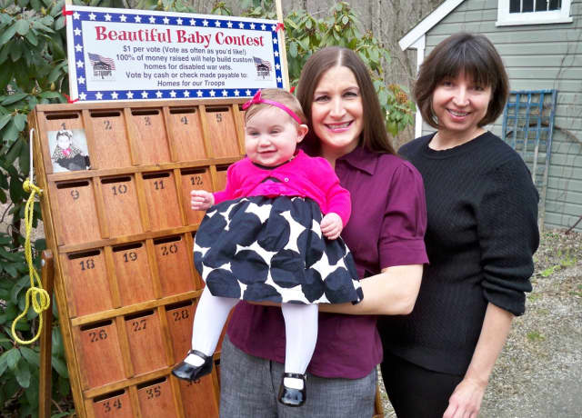 "Lois Barber is preparing to hold her annual Beautiful Baby Contest. Funds raised from the contest go to build ""smart houses"" designed to help improve the lives of wounded veterans."