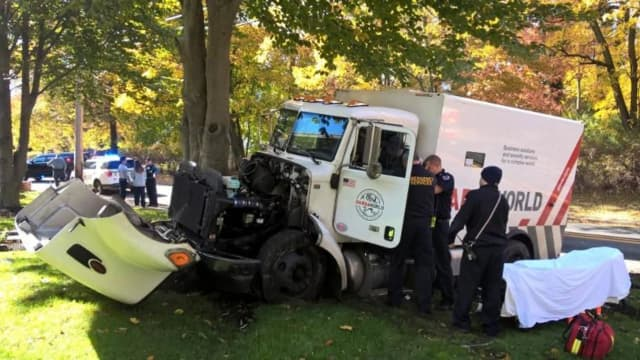 Security Officer Injured After Armored Car Crashes In