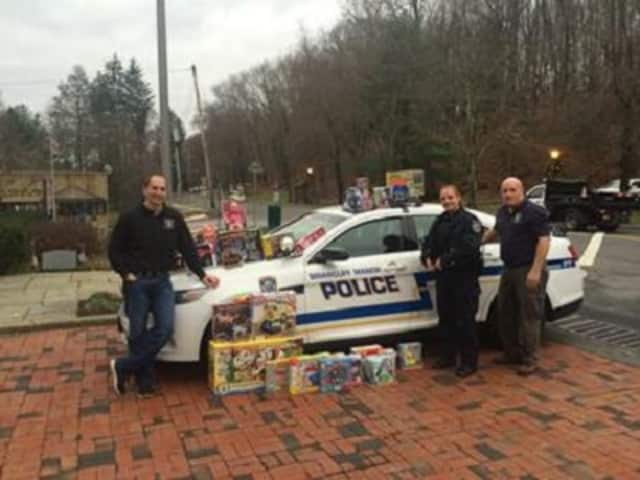 Officers Galbraith, DiMiglio and Wynn from the Briarcliff Police Department display some of the items that were collected for the annual toy and coat drives.