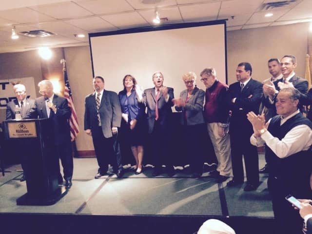 County Executive Jim Tedesco, center, with re-elected Freeholders Zur and Tanelli to his right.