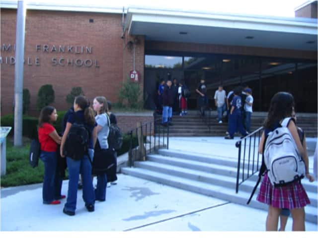 Students heading back into school after their summer vacation at Benjamin Franklin Middle School.