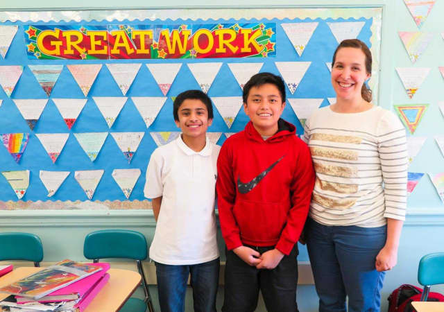 Sarthak Gandotra, left, and Franz Gloria of Bergenfield, with their teacher, Lisa Cooper