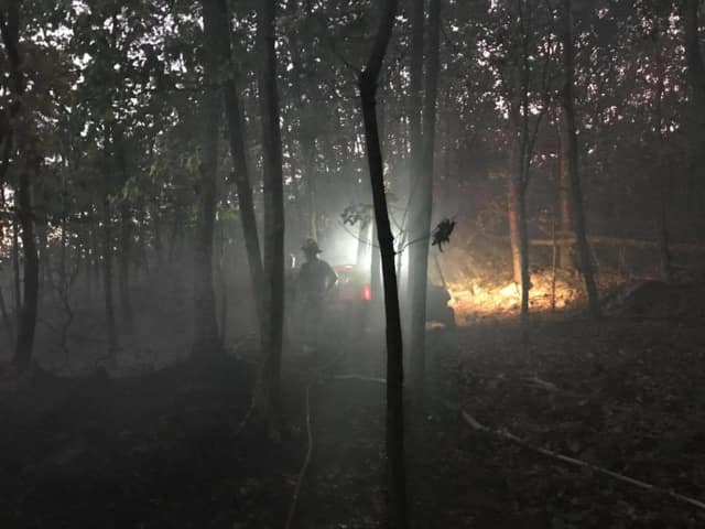 Firefighters from Bethel and surrounding towns battled a brush fire on Tuesday night and Wednesday morning.