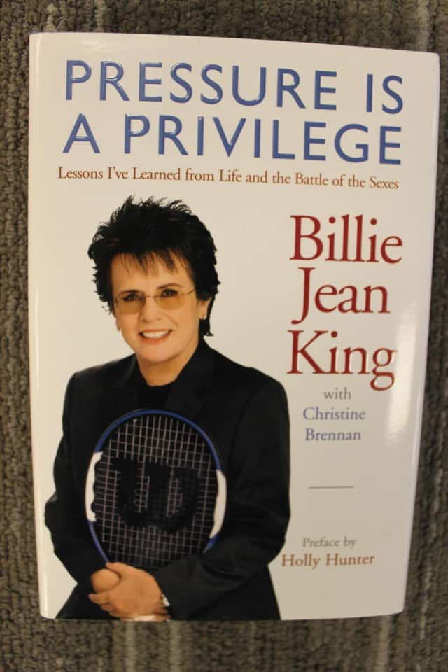 "This signed copy of tennis great Billie Jean King's ""Pressure is a Privilege"" will be up for grabs at the Pequot Library Black Friday/Saturday Book Sale."