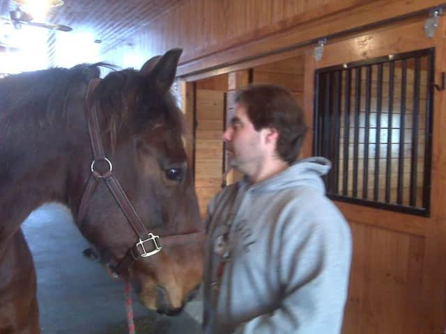 Brewster resident Rob Blassberg, with his horse Quite A Tan, is developing an online game and hopes to use proceeds to stop the cruel and inhumane deaths of former harness racing horses.