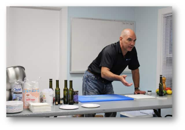 John Canevari, co-founder of The Blue Olive restaurant in Pawling conducts a cooking seminar June 28 at the Pawling Free Library.