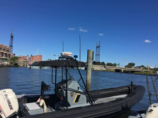 Members of the Norwalk Police Marine Unit rescued a boater who had gone overboard on Saturday.