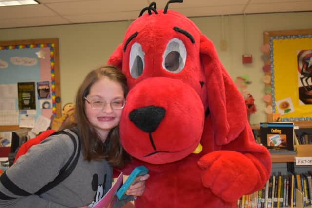 A student poses with Clifford at the BOCES Book Fair.