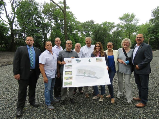 Essex County Executive Joseph N. DiVincenzo, Jr. (sixth from left) announced on Friday that work to create an off-leash dog park in Essex County Branch Brook Park in Newark was underway.