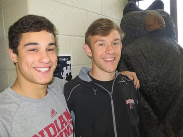 Mike Delfay and Brian Valedon enjoy posing with the Brewster Bear.