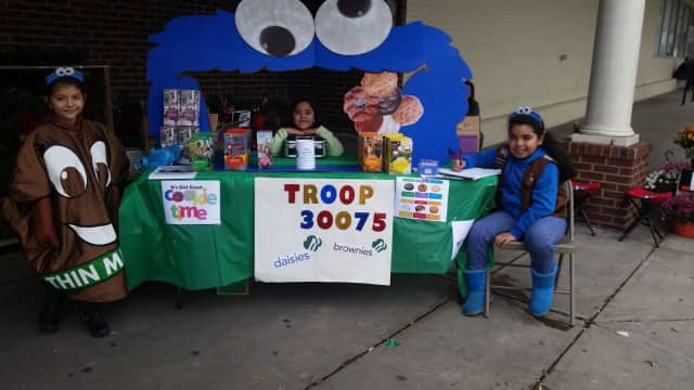 Girl Scouts sell cookies on Election Day.