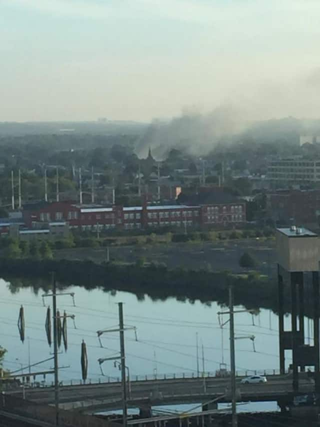 Smoke rises over Bridgeport on Wednesday morning due to a structure fire on Berkshire Avenue.