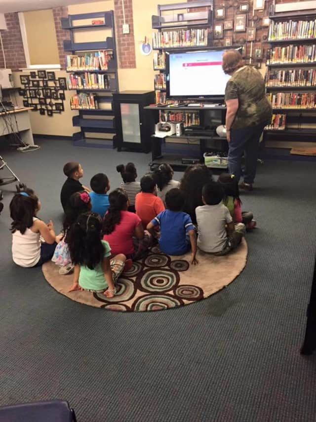 Children gather for a program at the Bridgeport Pubic Library. The library has acquired two sites that will allow for expanded programming.