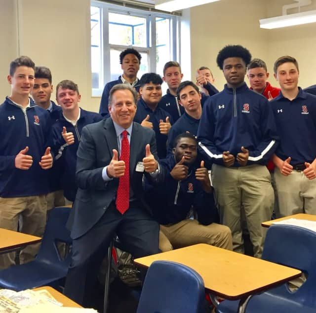 Bruce Beck poses with Stepinac students.