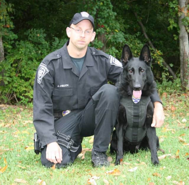 K-9 Bruno, shown with handler Jeff Osuch, passed away last month. Thanks to the generous gift of a local couple, the Brookfield police officer will be getting a new canine partner, town officials say.