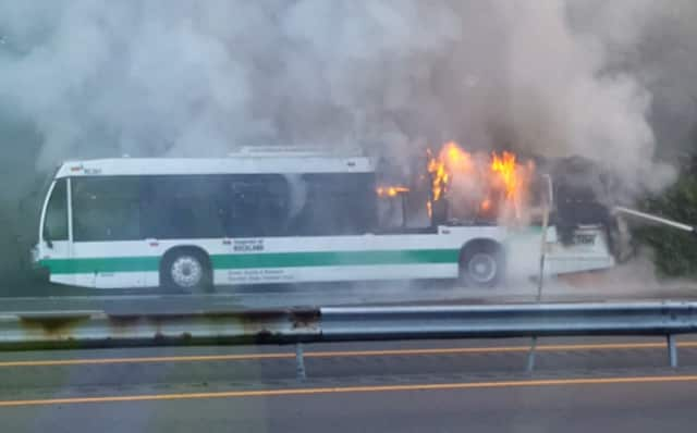 A Transport of Rockland bus burns on Interstate 87 in Ramapo early Monday. No injuries were reported in the early morning incident.