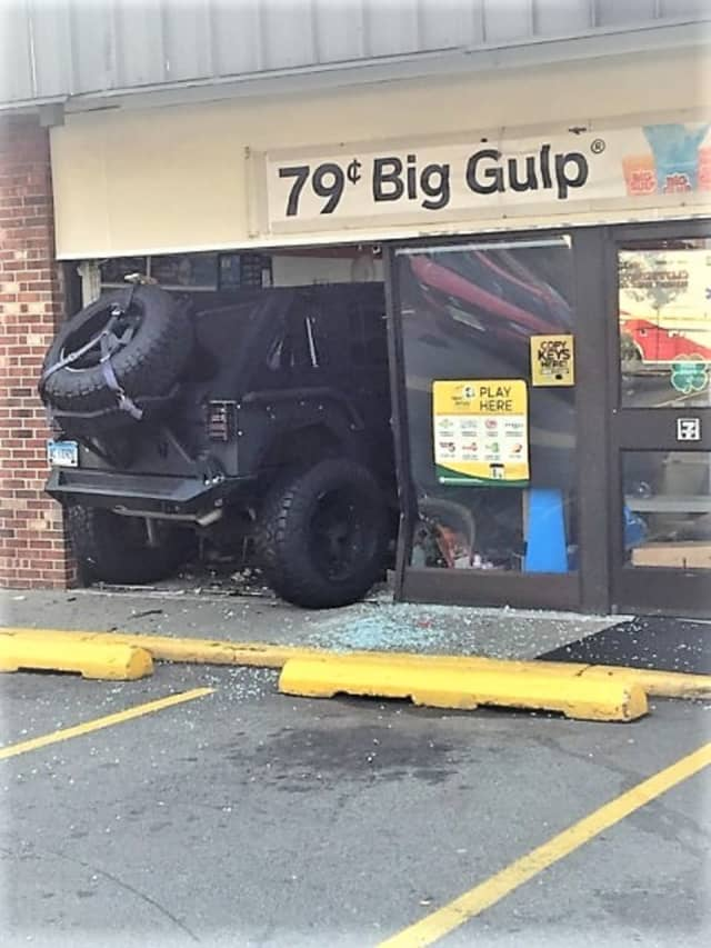 The Jeep crashed through the Cliffside Park 7-Eleven's front window.