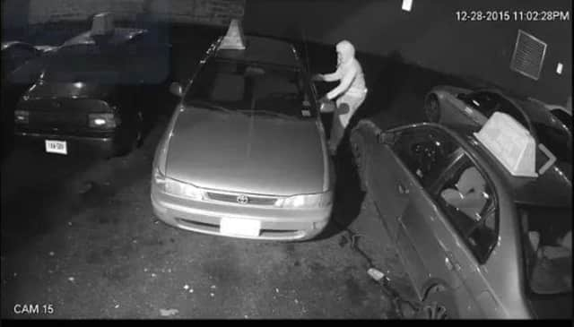 Footage from surveillance video of thieves trying several car doors until they find one that is unlocked.