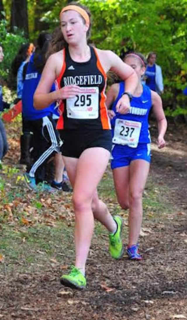 Carey Depuy runs for the Ridgefield High School cross country team at a race last year. The 2015 graduate died in a plane crash Sunday in New York.