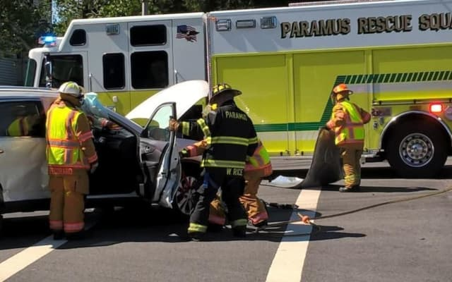 Members of the Paramus Rescue Squad freed the passenger in the Emerson crash.