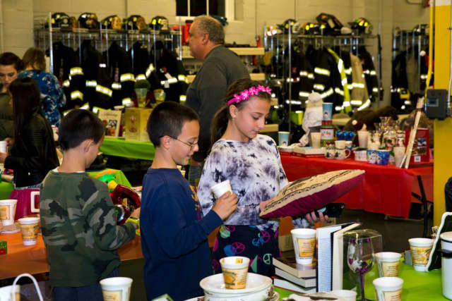 Besnik, Anthony and Julianna Sejfijaj gather at a table for the Penny Social, which was held by the Croton Falls Fire Department's Ladies Auxiliary.