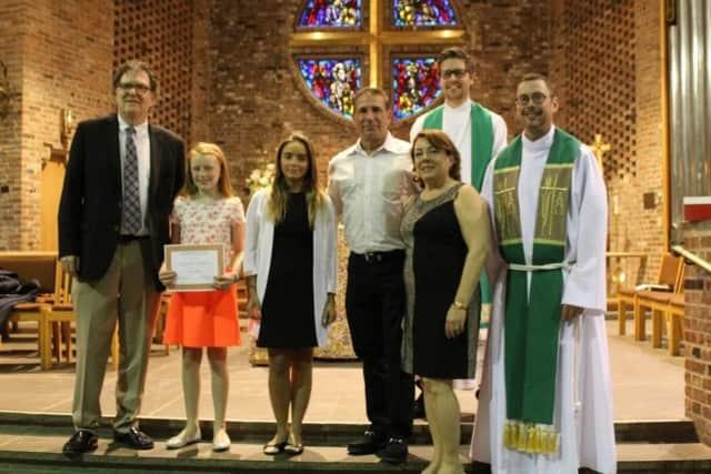 Chapel School fifth-grader Ciara receives the Carol and Christopher P. Kinghan Hearts of Giving Scholarship Award.