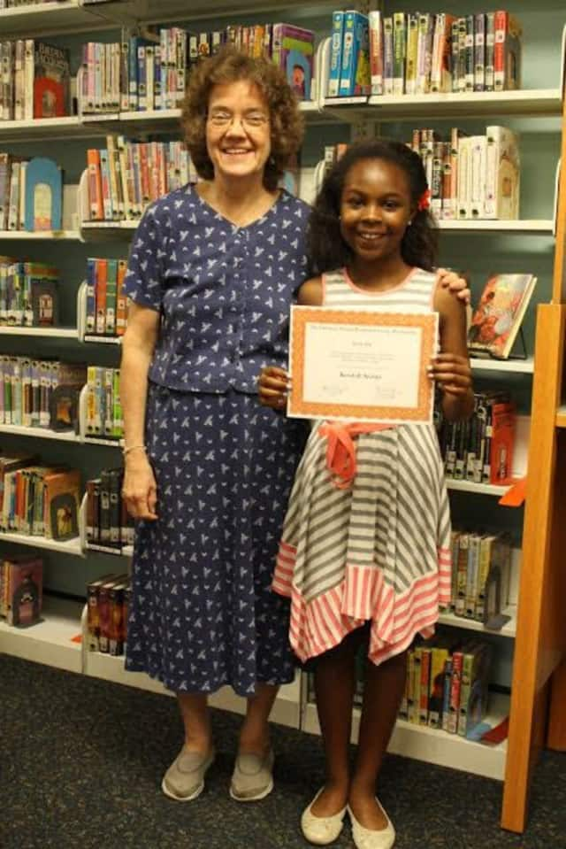 Chapel School student Kendall Archer was awarded the Librarian Sharon Peterson Literacy Scholarship named for school librarian Sharon Peterson Finster (Osenberg) who is retiring this summer.