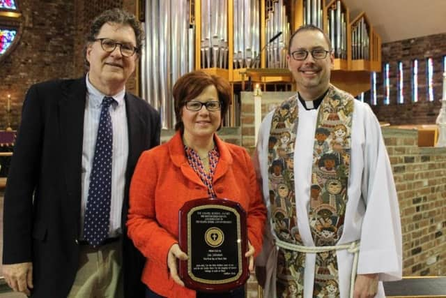 Bronxville resident Lisa Johnson, center, is the recipient of The Chapel School Award for distinguished service.