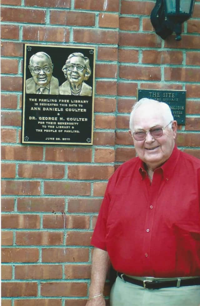 Dr. George M. Coulter next to his commemorative plaque.