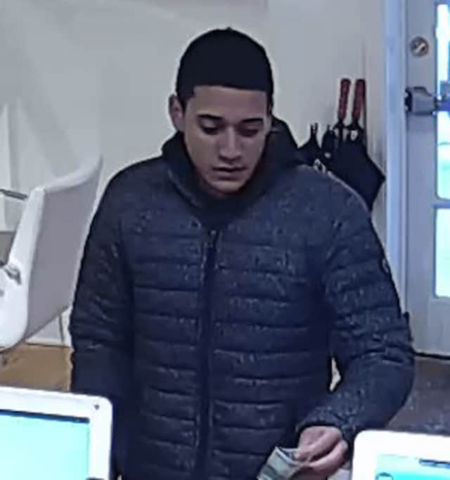 Police are seeking a suspect who purchased items with counterfeit $100 at several locations in Ridgefield last week