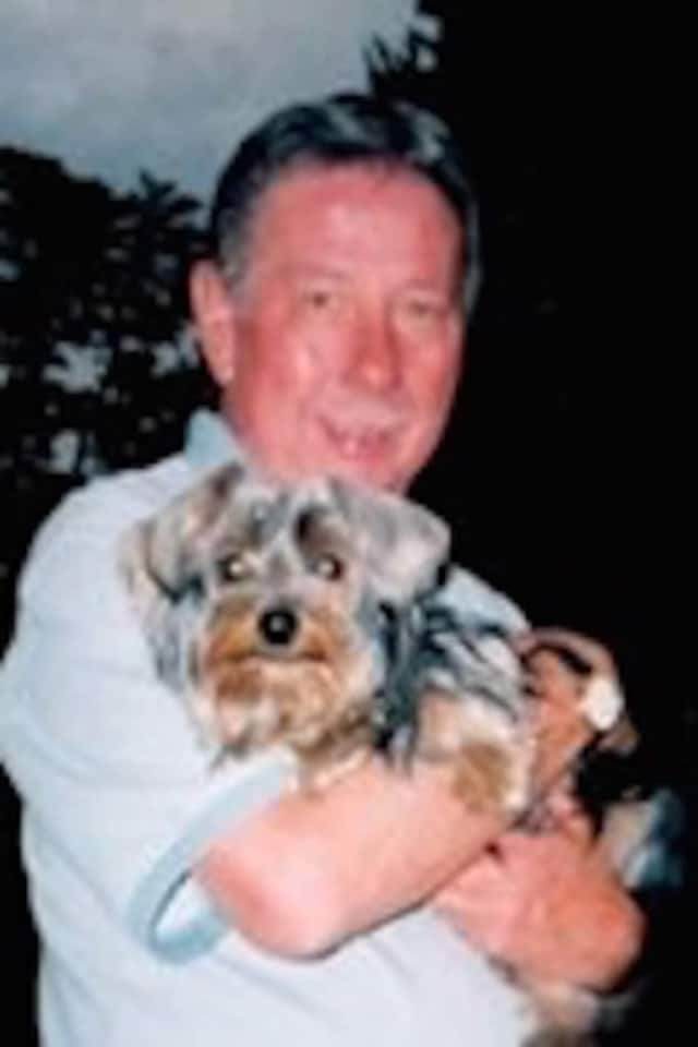 Jerome V. (Jerry) Guido and his dog Roxie