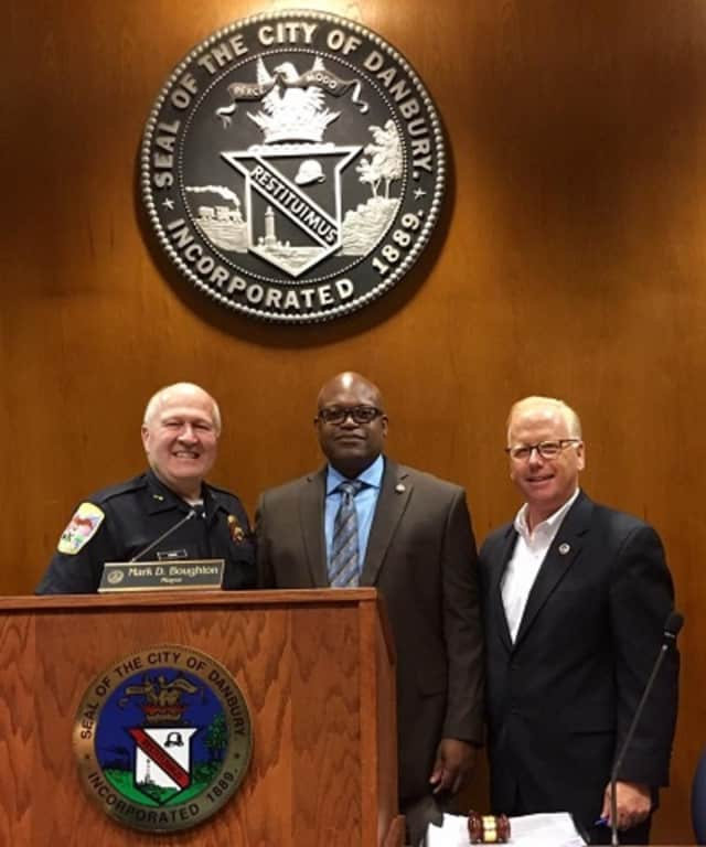 The appointment of Patrick Ridenhour, center, as Danbury's top cop was unanimously approved Tuesday by the City Council. At left is Al Baker, who is retiring as police chief in July. Mayor Mark D. Boughton is at right.