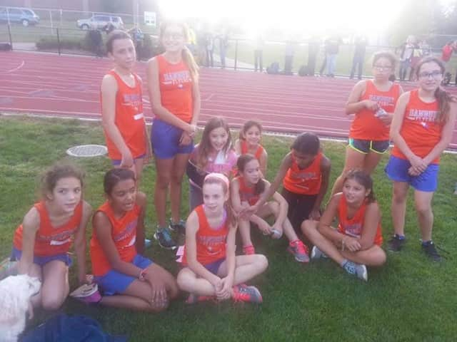 Girls on the Danbury Flyers youth cross country team take a breather after a race in Bethel.